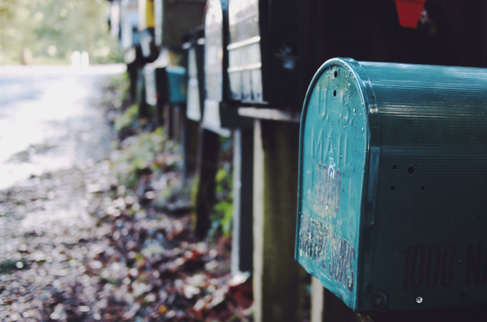 A row of mailboxes by the road.