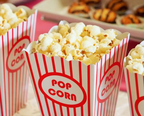 Three boxes of popcorn.