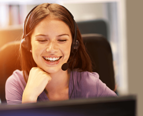 Girl with a headset on smiling.