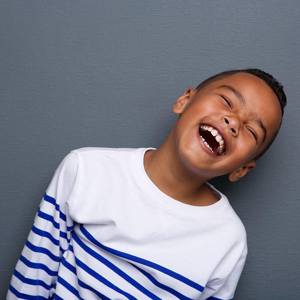 Young boy laughing.
