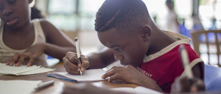 boy writing down